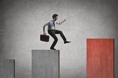 Businessman walking on a graph stock photo