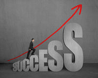 Businessman walking on growing success 3D word concrete interior Royalty Free Stock Image