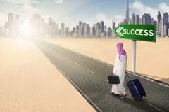 Businessman walking on highway with success text Royalty Free Stock Photos