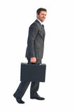 Businessman walking with his briefcase Stock Photo