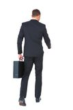 Businessman walking with his briefcase Stock Photos