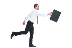 Businessman walking with his briefcase Stock Images