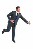 Businessman walking with his hands out Stock Photography