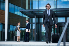 Businessman walking with his suitcase Stock Image