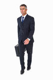 Businessman walking and holding briefcase Stock Images
