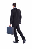 Businessman walking while holding briefcase Royalty Free Stock Photo