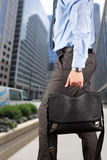 Businessman walking and holding  a  leather briefcase in his han Royalty Free Stock Photography