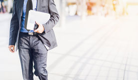 Businessman walking in a hurry. royalty free stock images