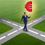 The businessman walking with inflatable euro sign Stock Photography