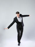 Businessman walking on invisible rope Royalty Free Stock Photo