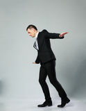 Businessman walking on invisible rope Stock Photography