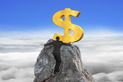 Businessman walking on iron chain toward dollar sign with clouds Royalty Free Stock Photo