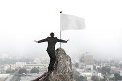 Businessman walking on iron chain toward white flag with citysca Royalty Free Stock Photos