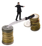 Businessman walking on knife. Holding balance. Walk away from the dollar to the euro. Euro collapses because of Greek coin Royalty Free Stock Photography