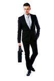 Businessman walking with laptop bag Stock Photography
