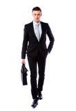 Businessman walking with laptop bag Royalty Free Stock Image