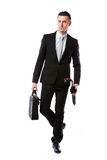 Businessman walking with laptop bag Stock Images