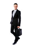 Businessman walking with laptop bag Royalty Free Stock Images