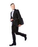 Businessman walking with laptop bag Stock Image