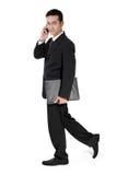 Businessman walking, looking aside royalty free stock images