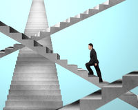 Businessman walking on maze stairs Stock Photography