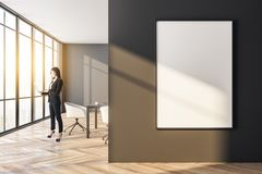 Businessman walking in modern meeting room. Side view of attractive european businesswoman with laptop standing in modern meeting room interior with empty royalty free illustration