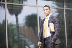 Businessman walking next to his office Stock Photos