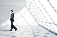 Businessman walking in office Royalty Free Stock Photo