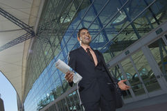 Businessman Walking Outside Office Building Royalty Free Stock Images
