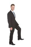 Businessman walking over white background Stock Photos
