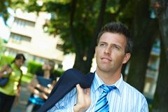 Businessman walking in park Royalty Free Stock Images