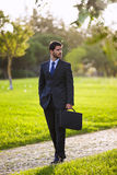Businessman walking at the park Stock Photo