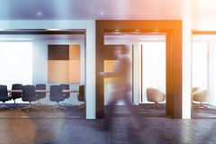 Businessman walking past beige conference room royalty free illustration