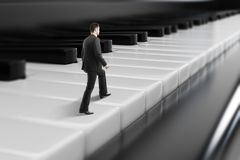 Businessman walking on piano keys. Side view of young businessman walking on abstract piano keys. Music, show business concept. 3D Rendering Royalty Free Stock Photo