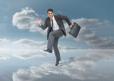 Businessman walking on a puddle Stock Images