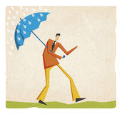 Businessman walking in the rain with umbrella Royalty Free Stock Photography