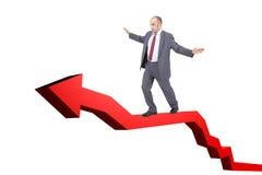 Businessman walking on a graph arrow Royalty Free Stock Photo