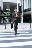 Businessman walking on red light Royalty Free Stock Photos