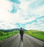 Businessman walking on road Stock Photos