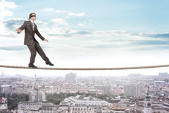 Businessman walking on rope Royalty Free Stock Photos