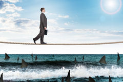 Businessman walking on rope Royalty Free Stock Photography