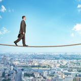 Businessman walking on rope Stock Photography