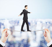 Businessman walking on the rope in the hands concept Royalty Free Stock Images