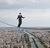 Businessman walking on a rope Stock Photos