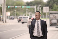 Businessman walking and smiling Stock Photo