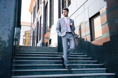 Businessman walking on stairs outdoors Royalty Free Stock Images
