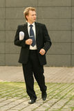 Businessman walking on the street Stock Image
