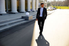 Businessman walking on the street Royalty Free Stock Photos