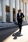 Businessman walking on the street Royalty Free Stock Photography
