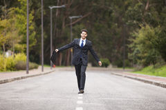 Businessman walking at the street Stock Images